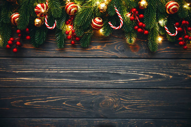 christmas background border with copy space,  ever green tree branches, candy cane,lights, holly berry - floral garland stock pictures, royalty-free photos & images