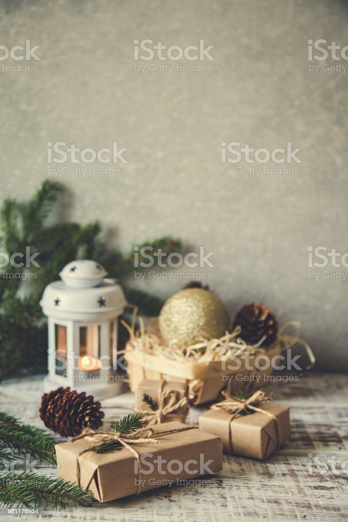 Christmas background. Christmas composition. Christmas gift, pine cones, fir branches on wooden white background. stock photo