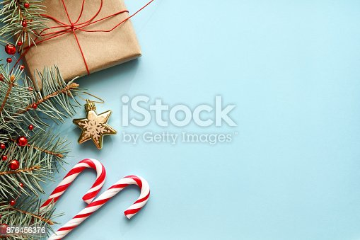 istock Christmas background. Christmas gift, fir tree, candy canes and decorations 876456376