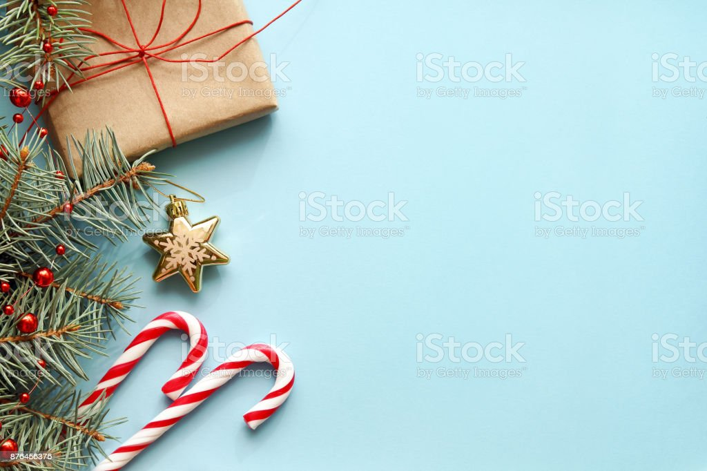 Christmas background. Christmas gift, fir tree, candy canes and decorations stock photo