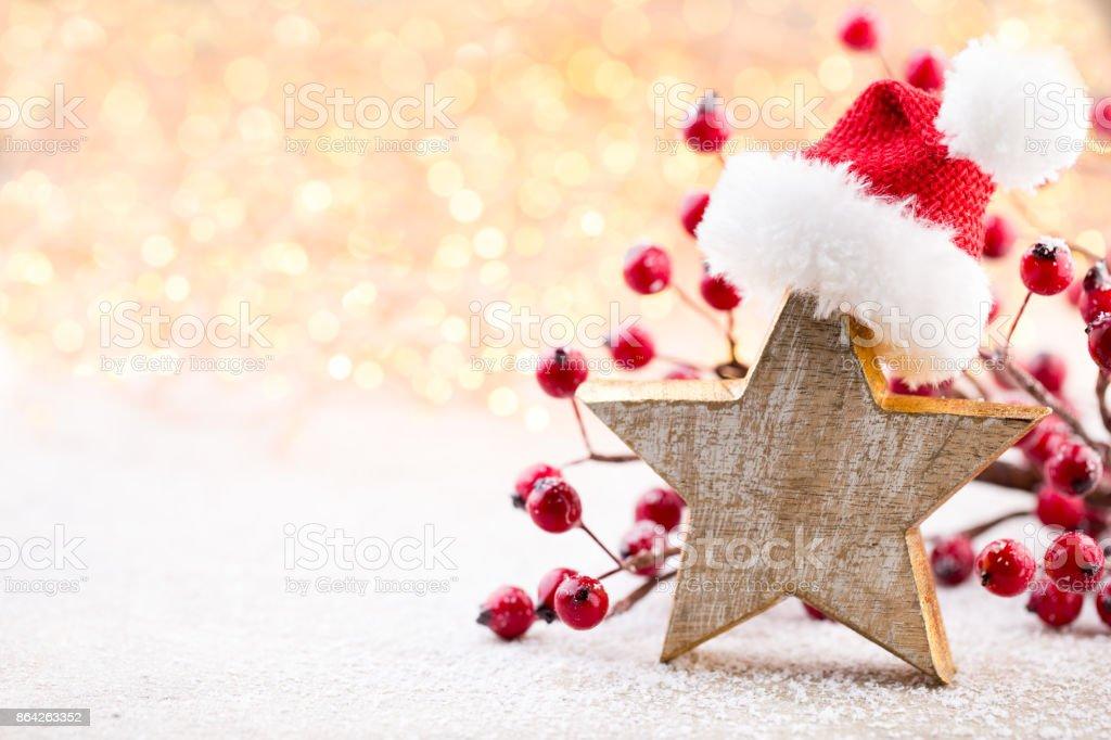 Christmas background. Christmas star and santa hat. Greeting card. royalty-free stock photo
