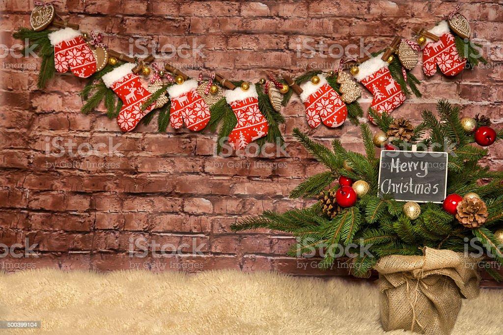 Christmas background, decorated brick wall . stock photo