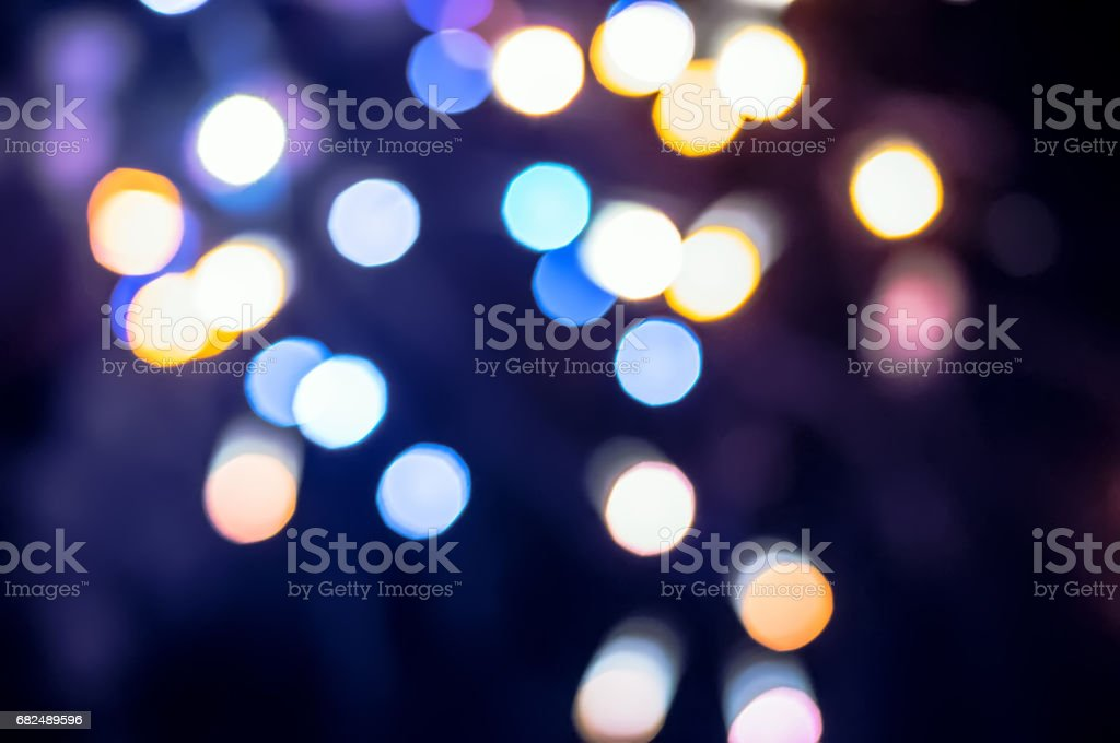 Christmas background. Festive abstract holidays background with bokeh defocused lights and stars. royalty-free stock photo