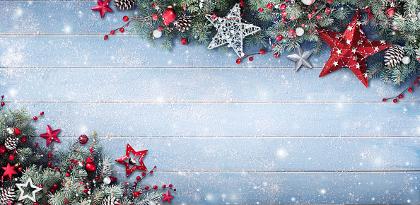 istock Christmas Background - Fir Branches And Baubles On Snowy Plank 857441222