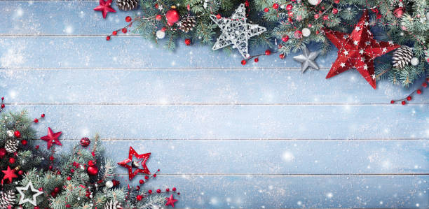 christmas background - fir branches and baubles on snowy plank - christmas stock photos and pictures