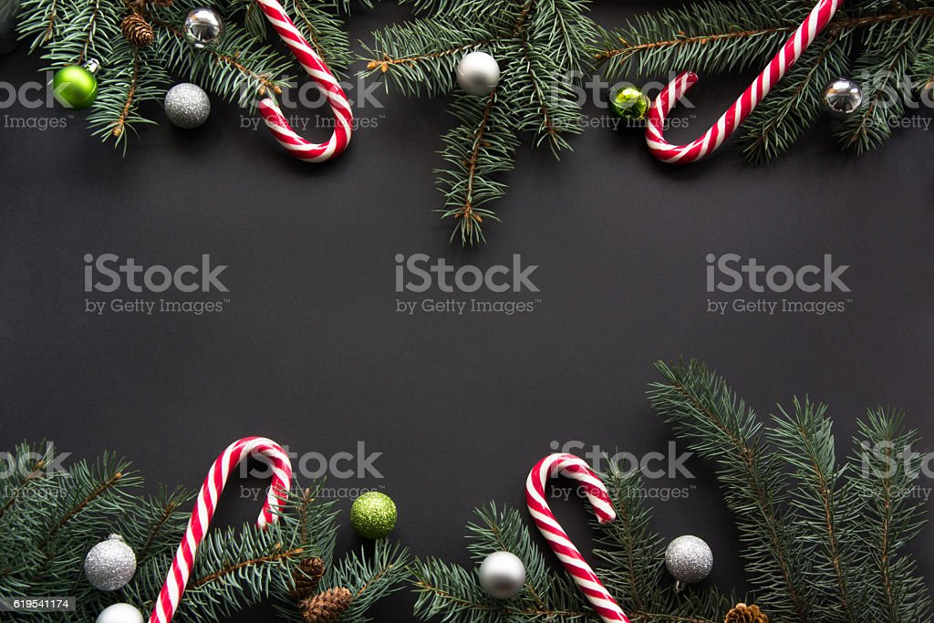 Christmas background. Fir-tree branches on black with copyspace. Top view. stock photo