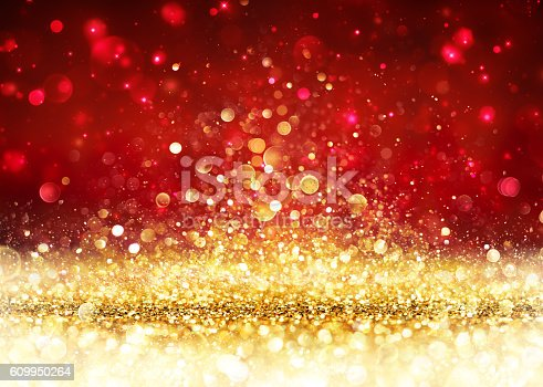 istock Christmas Background - Golden Glitter On Shiny Red 609950264