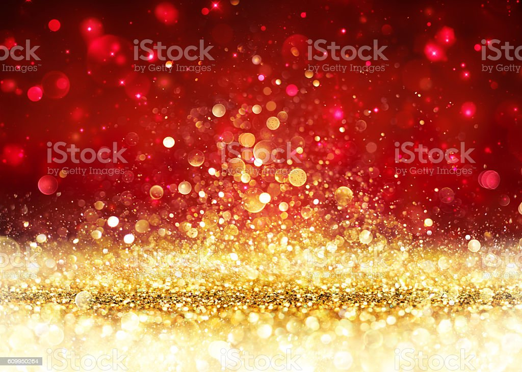 Christmas Background - Golden Glitter On Shiny Red stock photo