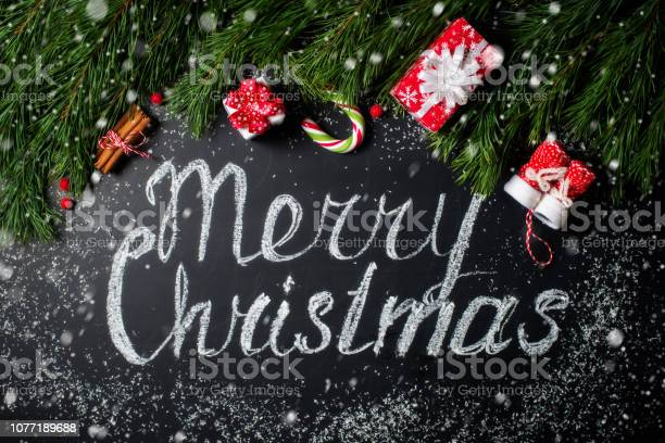 Christmas background merry christmas lettering chalk board fir gift picture id1077189688?b=1&k=6&m=1077189688&s=612x612&h=wufybubgin6avlp5zoz7g 0x5brbryk0q ttrnreafa=
