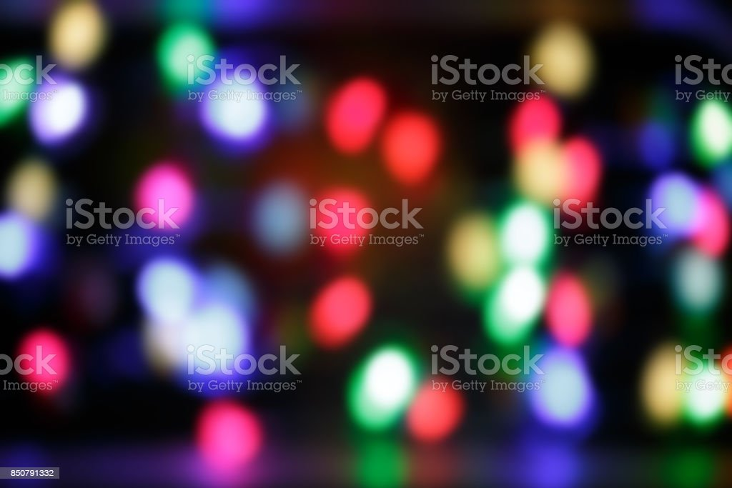 Christmas background of colorful glowing lanterns on black backg stock photo