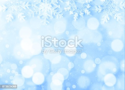 istock Christmas background on blue background and bokeh 873929088