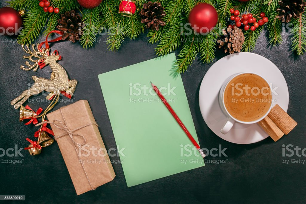 Christmas background or Xmas card  with decorations fir, gift box and ornamen. Space for Holiday Greetings.  Top view. Planning of New Year's holidays stock photo