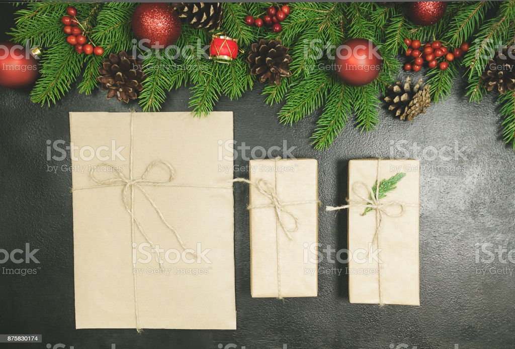 Christmas background or Xmas card  with decorations fir, gift box and ornamen. Space for Holiday Greetings.  Top view. Goal, planning winter holiday stock photo