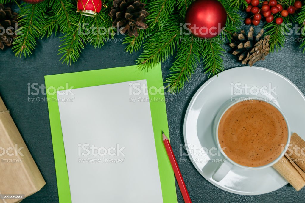 Christmas background or Xmas card  with decorations fir, gift box and ornamen. Space for Holiday Greetings.  Top view. Goal, planning winter holiday. Black backt stock photo