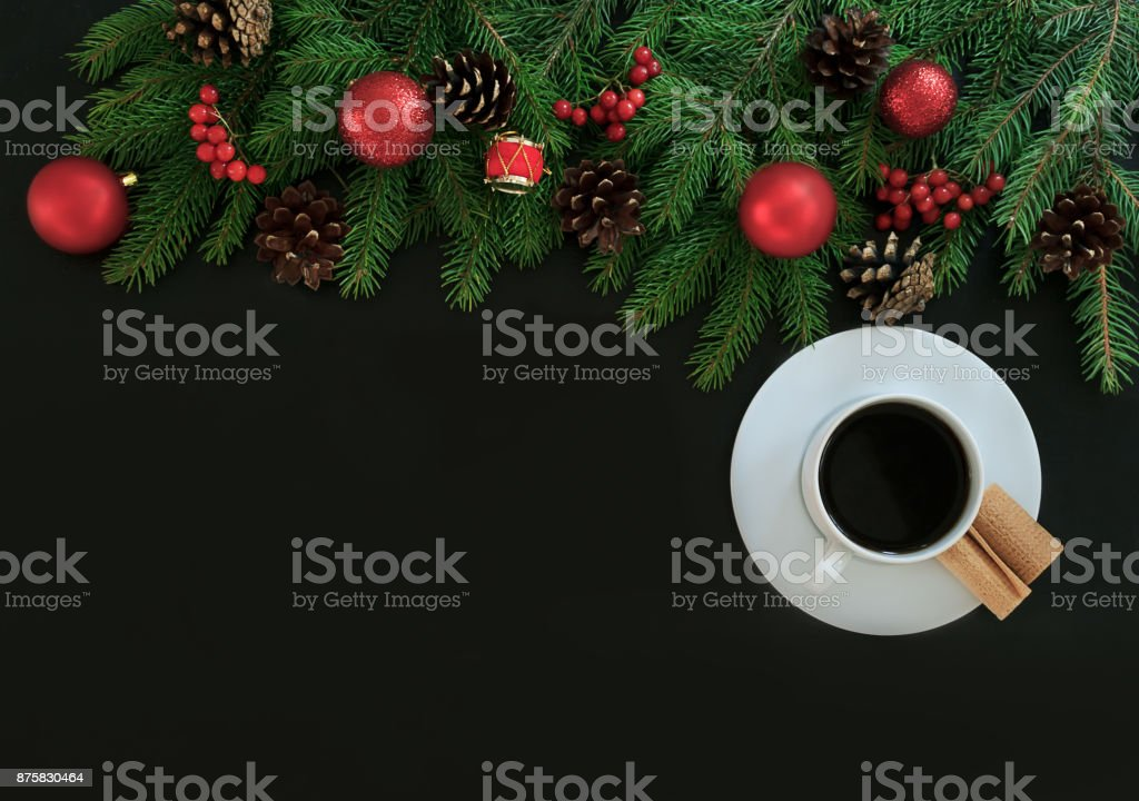 Christmas background or Xmas card  with decorations fir, gift box and red ornamen. Space for Holiday Greetings.  Top view. Goal, planning winter holiday stock photo