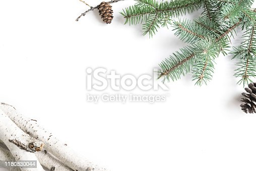 Fir Branches and Firewoods - winter seasonal creative flat lay, Christmas composition, hygge concept isolated on white background.