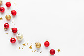 Christmas Composition with golden and red festive balls and stars, isolated on white background,  copy space. Christmas creative flat lay, concept with festive ornaments.