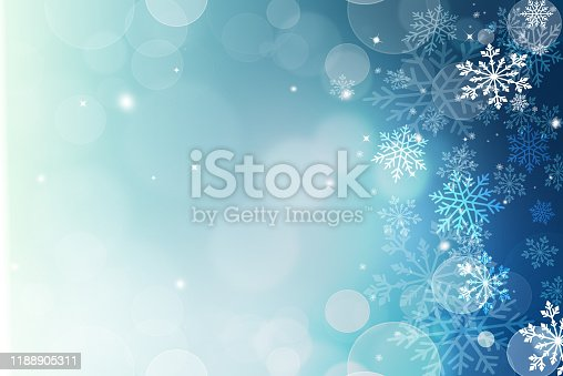 Abstract blue and white Christmas background with snowflakes and bokeh. Christmas background