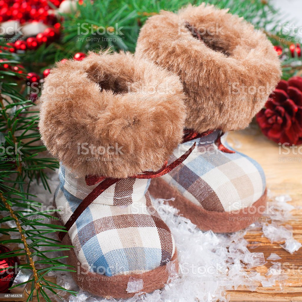 vintage plush bear in snow shoes ornament