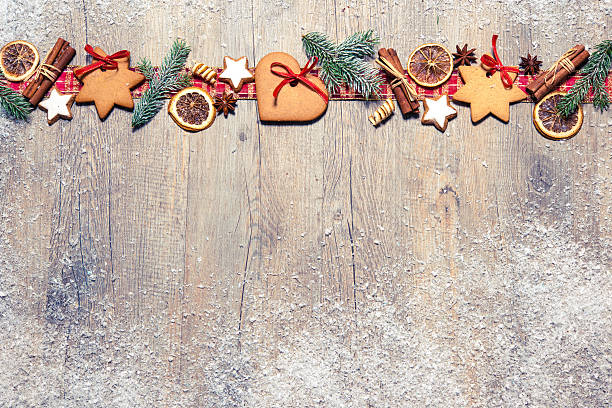 Christmas background Christmas background with cookies, fir branches and spices on the old grunge wooden board salé morocco stock pictures, royalty-free photos & images