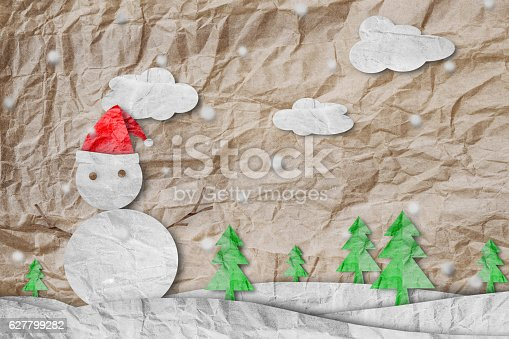 527392693 istock photo Christmas Background, Snowman in winter,made of crumpled paper cut 627799282