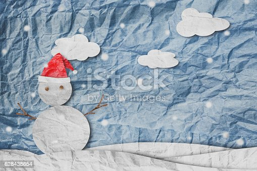 527392693 istock photo Christmas Background, Snowman in winter,made of crumpled paper cut 628438654