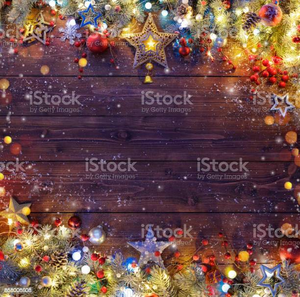 Christmas background snowy fir branches and lights on dark table picture id858008608?b=1&k=6&m=858008608&s=612x612&h=bfg9tczkr eb5xslh7v3kozsnm j08viagjix3uumjw=