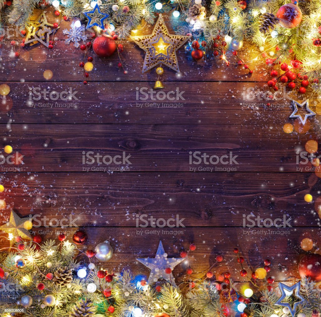 Christmas Background - Snowy Fir Branches And Lights On Dark Table stock photo