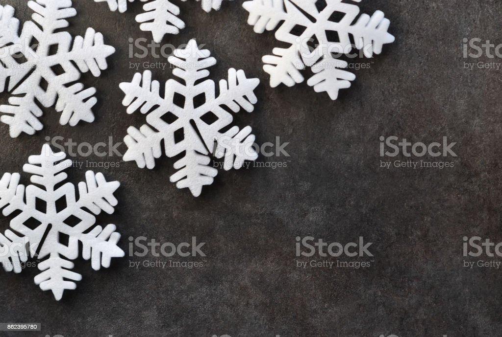 Christmas background - white, decorative snowflake on black background concrete stock photo