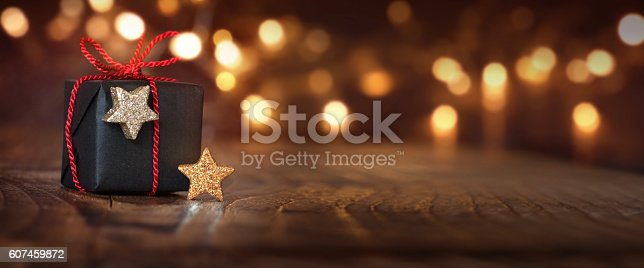 istock Christmas background with a gift 607459872