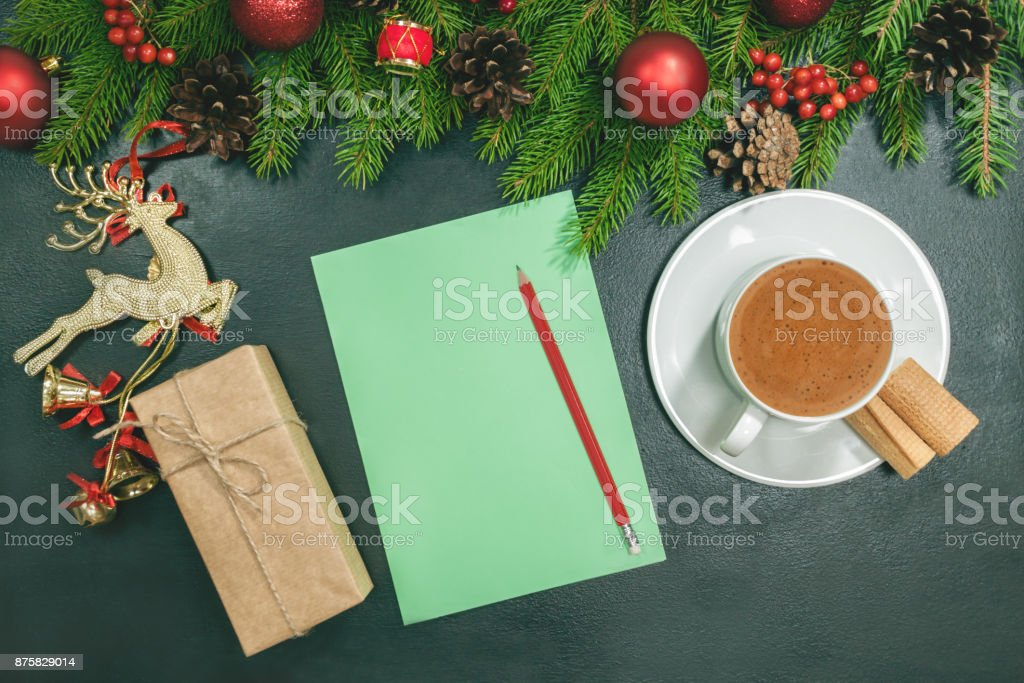 Christmas background with blank notebook, fir branches, decorations and gift boxes. Space for text. Top view. Christmas to-do list or wish list. Black  design stock photo