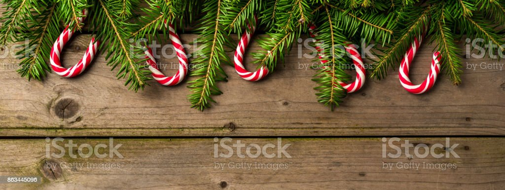 Christmas background with candy canes on white wooden table stock photo