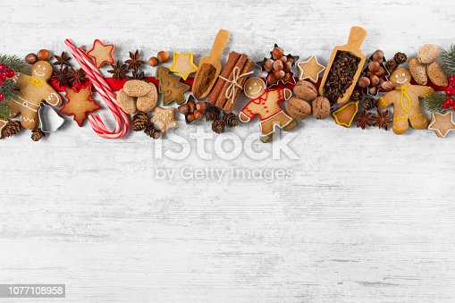 Christmas background with Christmas cookies, Christmas decoration and spices on white wooden background.