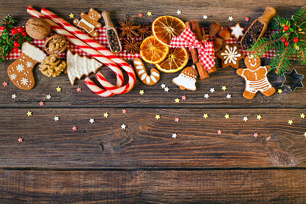 christmas background with christmas cookies, decoration and spices - christmas stock photos and pictures