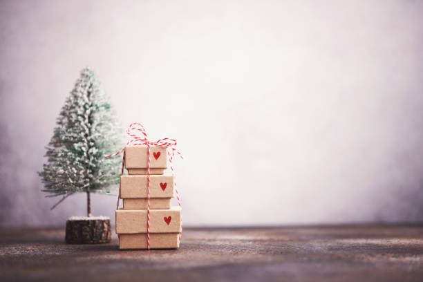 Christmas Background with Christmas Tree with Tiny Gift Stack stock photo