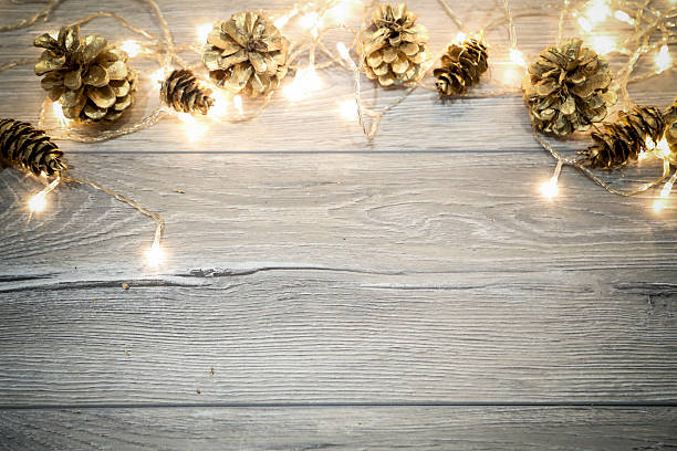 christmas background with  cones on wooden table - vintage ornaments stock photos and pictures