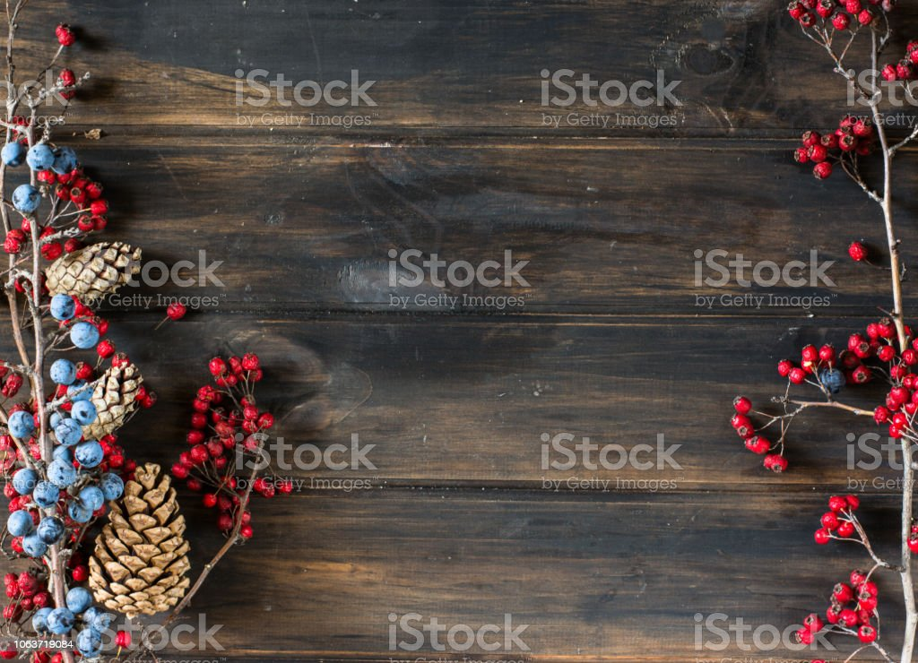 christmas background with copy space. New Year background with decorations. Cone, berries, blackthorn, hawthorn. Winter branch. Christmas composition. Holiday composition. Xmas decoration. Yule. stock photo