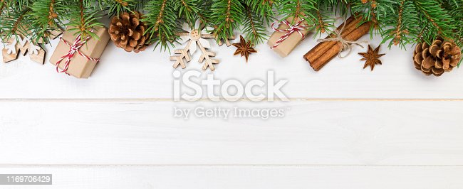 istock Christmas background with copy space, top view. holiday concept for you design on banner wooden table 1169706429