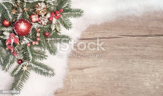 istock Christmas background with decorated Christmas tree twigs on snow. 835226838