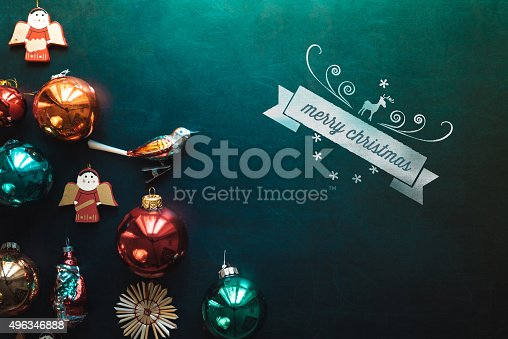 istock christmas background with decoration on blackboard and  text ribbon 496346888