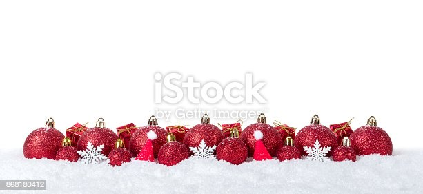 istock Christmas background with decorations and christmas balls on snow isolated on white background 868180412