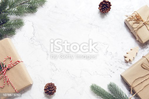 istock Christmas background with decorations and gift boxes on white marble. 1078873252