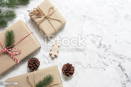 istock Christmas background with decorations and gift boxes on white marble. 1084211386