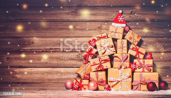 istock Christmas background with decorations and gift boxes 1043061990