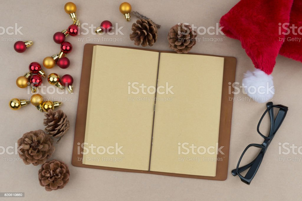 Christmas background with decorations, gift box and blank notebook. Space for text. Top view. stock photo