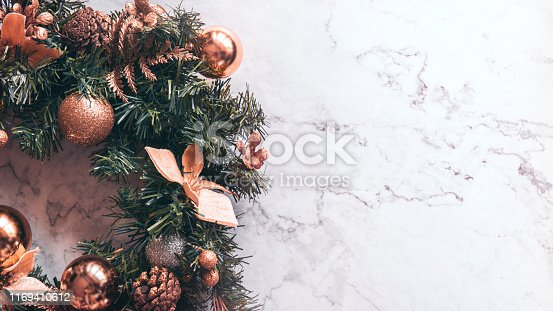 Christmas background with decorations on white marble. copy space.