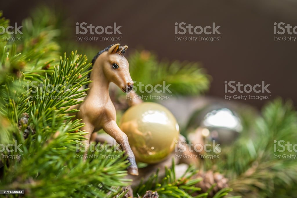 Christmas Horse Decorations.Christmas Background With Decorations On Wooden Board New Year Pine Branch Decore With Horse Toy And Balls Stock Photo Download Image Now