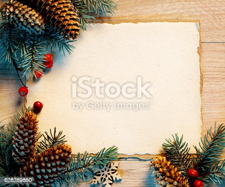 istock Christmas background with fir branches,pinecones and berries 628289850