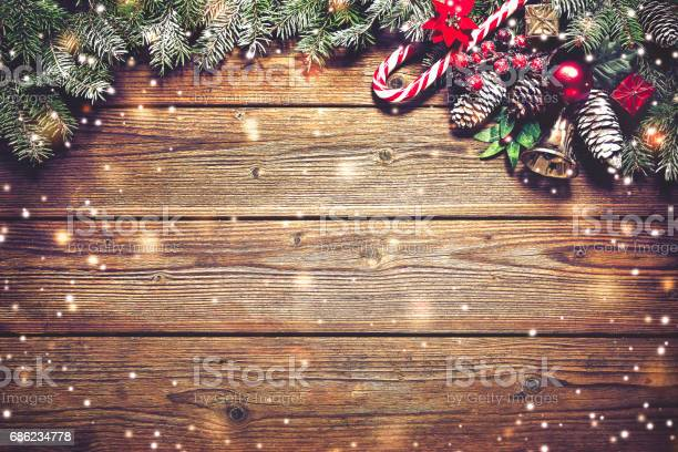 Christmas background with fir tree and decoration picture id686234778?b=1&k=6&m=686234778&s=612x612&h=hkblo0qqif02ulitsvg8trh 77wtti9 1p5rvc208ic=