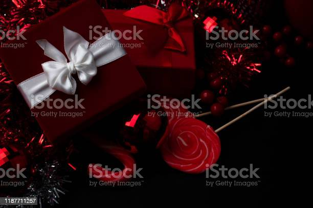 Christmas background with gift boxes and christmas decorations picture id1187711257?b=1&k=6&m=1187711257&s=612x612&h=5sm6wsjtwyv yfb9lxytqgprxqm5tknnsoqyzq0hvqy=